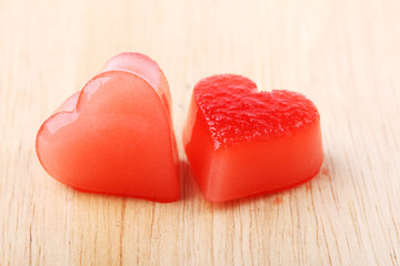 two red heart-shaped ice from raspberry syrup