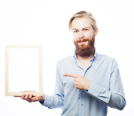 bearded  man holding a picture frame