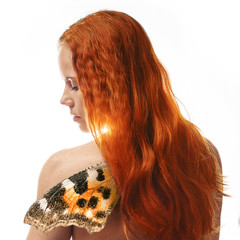 Redhead girl with butterfly