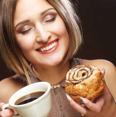 young woman with coffee and cookies.