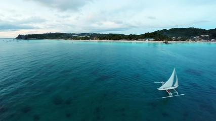 Aerial flight above white beach at Boracay Beach