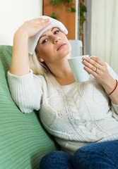 Ordinary woman with huge migraine