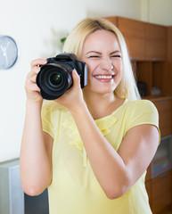 Female photographer testing new camera