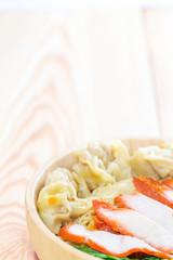 bowl of noodles with pork dumpling and vegetables