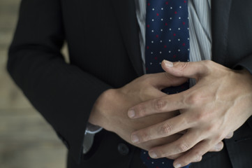 Businessmen are holding the stomach