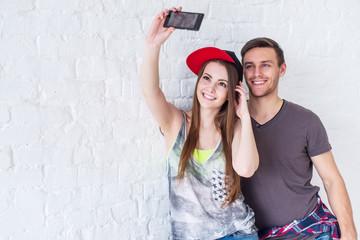 Couple friends taking selfie self-portrait picture photo