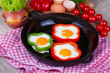 Fried eggs in peppers