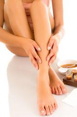 Beautiful young latin woman with silky skin, waxing her legs