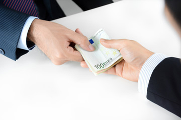 Businessman hands giving & receiving money, Euro currency (EUR)