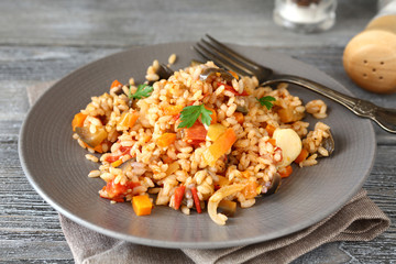 Pilaf with vegetables on a plate