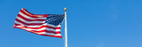 American flag against blue sky - 83494546