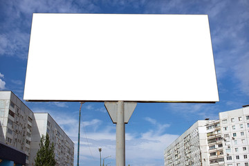 Blank billboard against  blue sky in the city