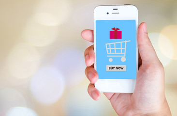 Buy now on smart phone screen in hand, e-business concept