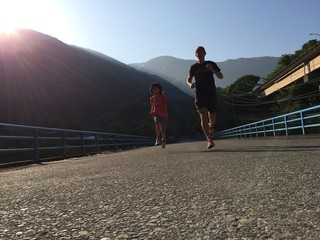 Father and daughter running together
