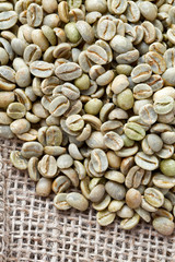 green coffee beans on sack