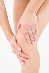 Natural woman touching her painful knee