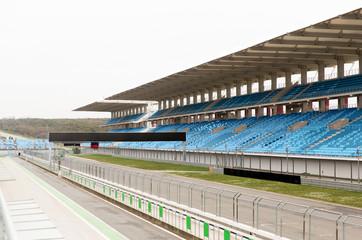 empty speedway and bleachers on stadium