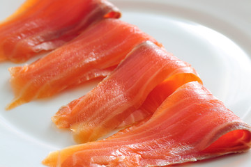 slices of salmon on a white plate