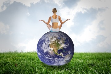 Composite image of fit woman doing yoga