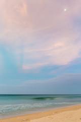 Pastel dusk time on desert beach with moon
