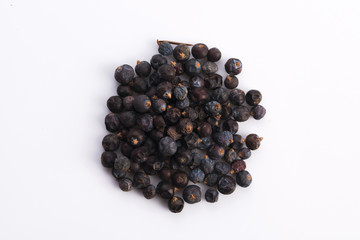 Juniper berries on white background