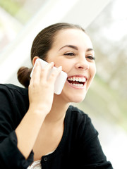 Delighted young woman listening to a phone call