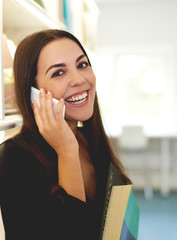 Young woman chatting on a smart phone