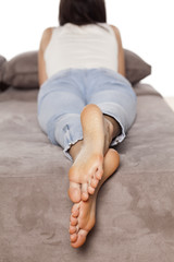 Beautiful female bare feet of a woman who lies and rests
