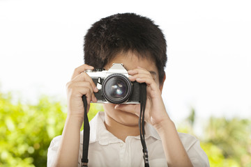 young photographer, An Asian boy shooting with old film camera
