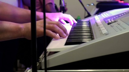 Musician playing the keyboard at the party