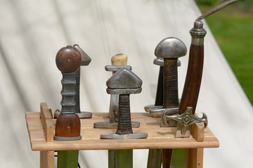 Viking sword handles in sword rack