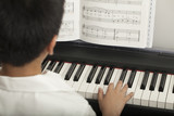 Fototapety piano lesson, Asian boy kid activity playing piano with notes