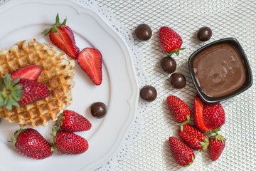 Belgian waffles with strawbery on white plate