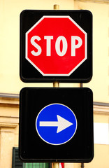 Prohibitive stop sign and arrow traffic sign. Italy.