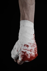 bloody hand in a bandage, bloody bandage, black background