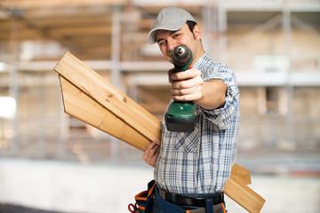 Portrait of a carpenter in a construction site