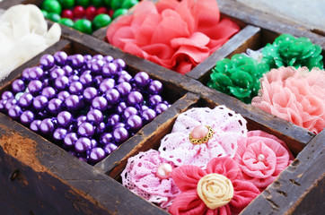 Collection of  brooches, beads and hair pins in wooden box