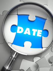 Date - Puzzle with Missing Piece through Loupe.