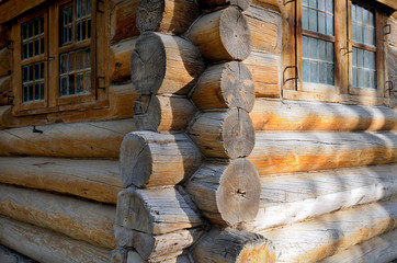Corner of Russian old wooden house from logs