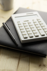 Calculator and Notebook on Desk