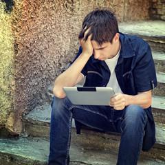 Sad Teenager with Tablet Computer