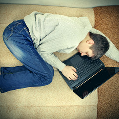 Young Man sleep with Laptop