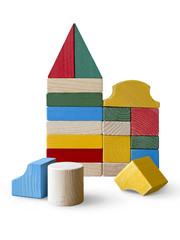 Houses made from wooden toy blocks on white background