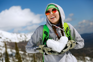 Portrait of young snowboarder girl