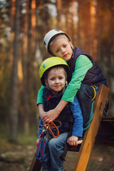 Two brave adorable  boys, double portrait, kids sitting and smil