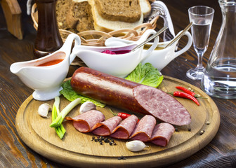 sausage on a wooden plate in a restaurant