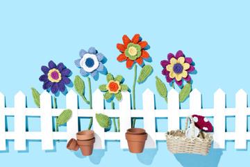 gehäkelte Blumen mit Gartzenszene