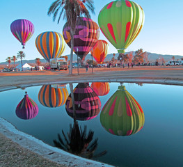 USA, Arizona, Mohave County, Lake Havasu City, Beachcomber Boulevard, Lake Havasu, Lake Havasu Balloon Festival, Hot Air Balloons reflected in pond