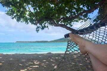 Fiji, Person lying on hammock on beach