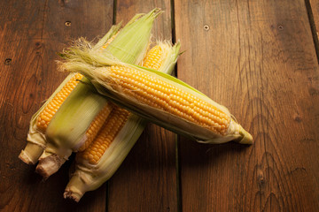 Corn vegetable on wooden picnic table background